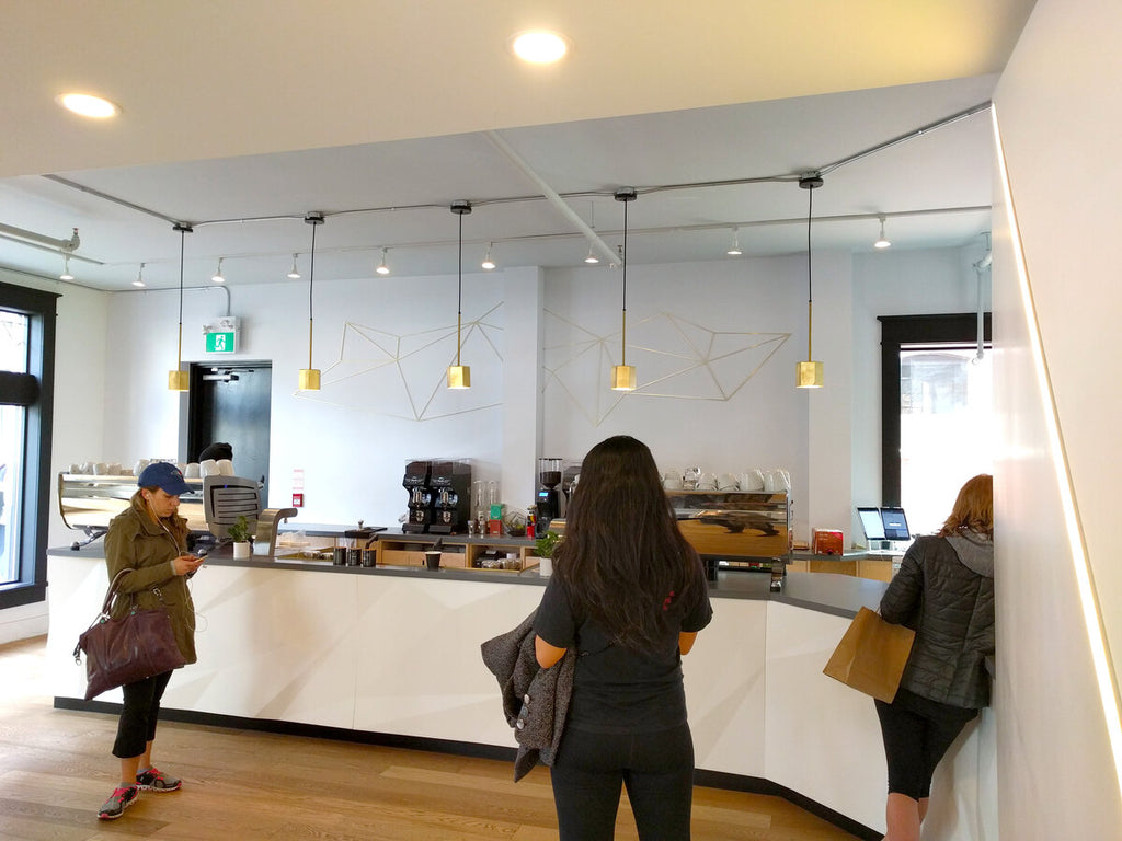 Customers waiting for beverages at Quantum Coffee