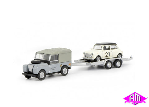 Land Rover 88 with Mini Cooper on car trailer
