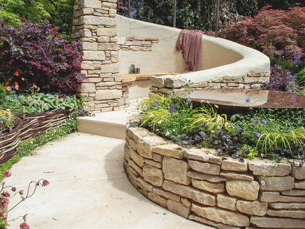 BUILDING A NATURAL STONE RETAINING WALL WITH PURBECK RANDOM WALLING STONE