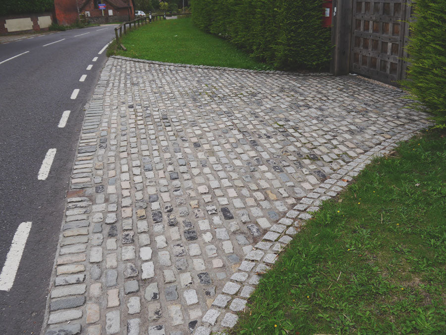 Reclaimed granite street cobbles driveway entrance