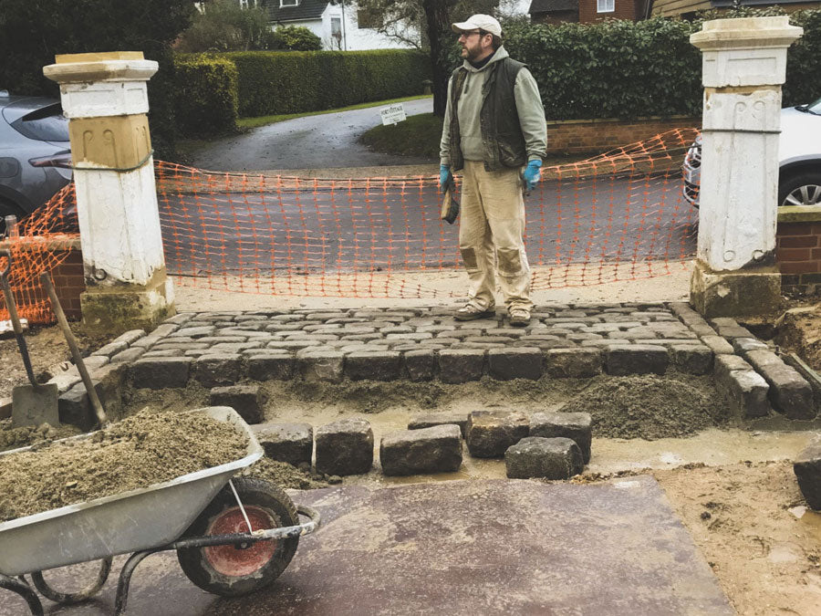 Laying natural reclaimed cobbles driveway