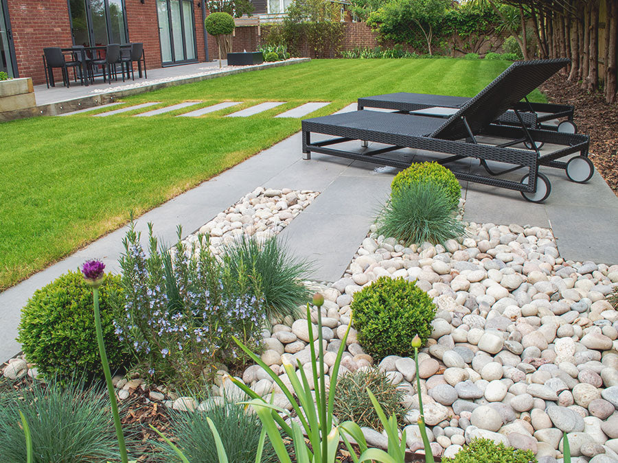 Patio with grey porcelain paving and cobbles