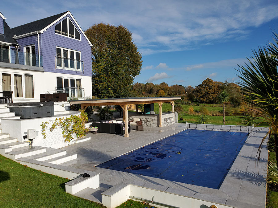 Grey porcelain paving patio tile with swimming pool and coping stones
