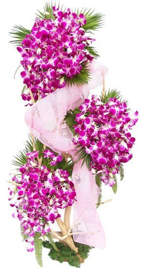 Three tier arrangement of purple Orchids with 75 stem arranged nicely with the help of stand.