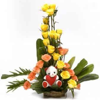 30 Bright Roses and a small teddy situated in basket.