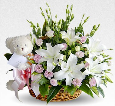 Basket of 20 + lilies and carnations.