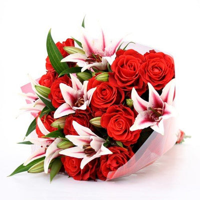 Pink Lilies and Red Roses Love bouquet wrapped in cellophane paper (20+ Flowers)