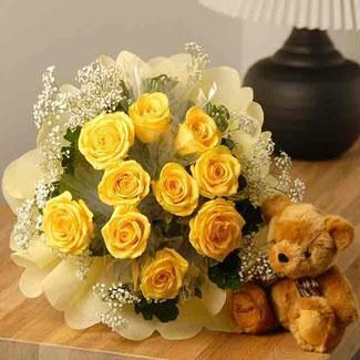 Dozen Yellow Roses bouquet with special crape paper packing and a cute teddy bear (6 inch)