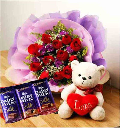12 Stem Red Roses wrapped in special crape paper