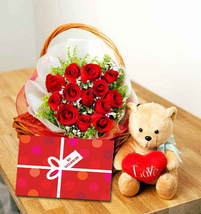 18 stem Red Roses arranged in a cane basket.