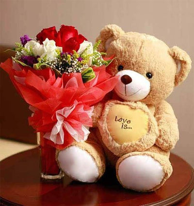•	Bunch of Dozen Red and White Roses wrapped in special packing.