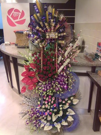 4-5 feet tall arrangement having more then 200 flowers ( Orchids, Roses, Anthoriums & Tube Roses )