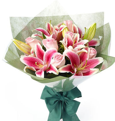 Pretty Pink Roses and Exotic Pink Lilies gorgeous bouquet with special Pink wrap on it
