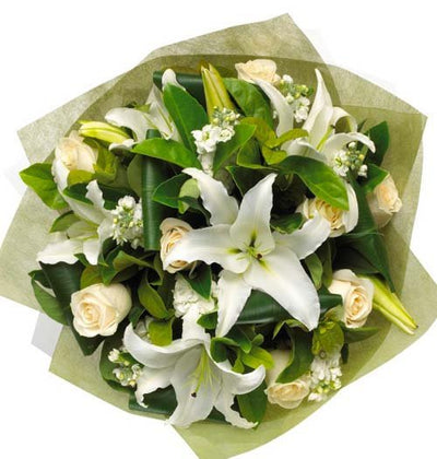 White Lilies and White Roses arranged in a gorgeous bouquet with cellophane paper wrap