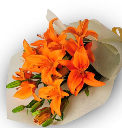 5 stem exotic orange Lilies Bouquet wrapped in cellophane paper