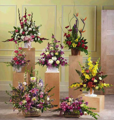 7 Different arrangement of Exotic Mixed Flowers arranged with Glass VASE and Cane Baskets.