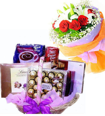 Bouquet of Red Roses and exotic Lily wrapped in special paper packing