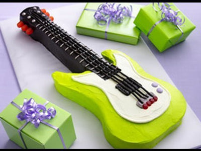 Musical Guitar Shape Cake is perfect for Music freak guys. 