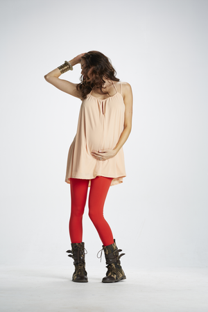 Lifestyle Shot of Kiss Me Hello Red Maternity Leggings