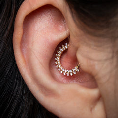 Women with daith piercing in 14ct gold