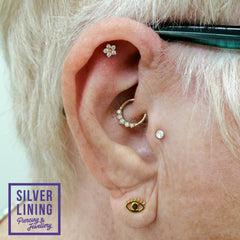 Woman with daith piercing in gold