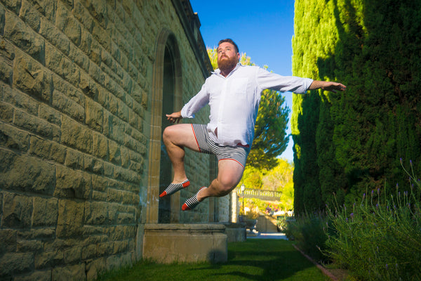 Mikey Roe in Related Garments jumping in his underwear and no-show socks at Graystone Manor in Beverly Hills