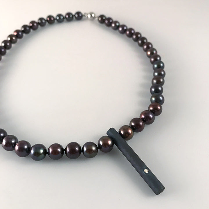 Grey Pearl Necklace with a Twist