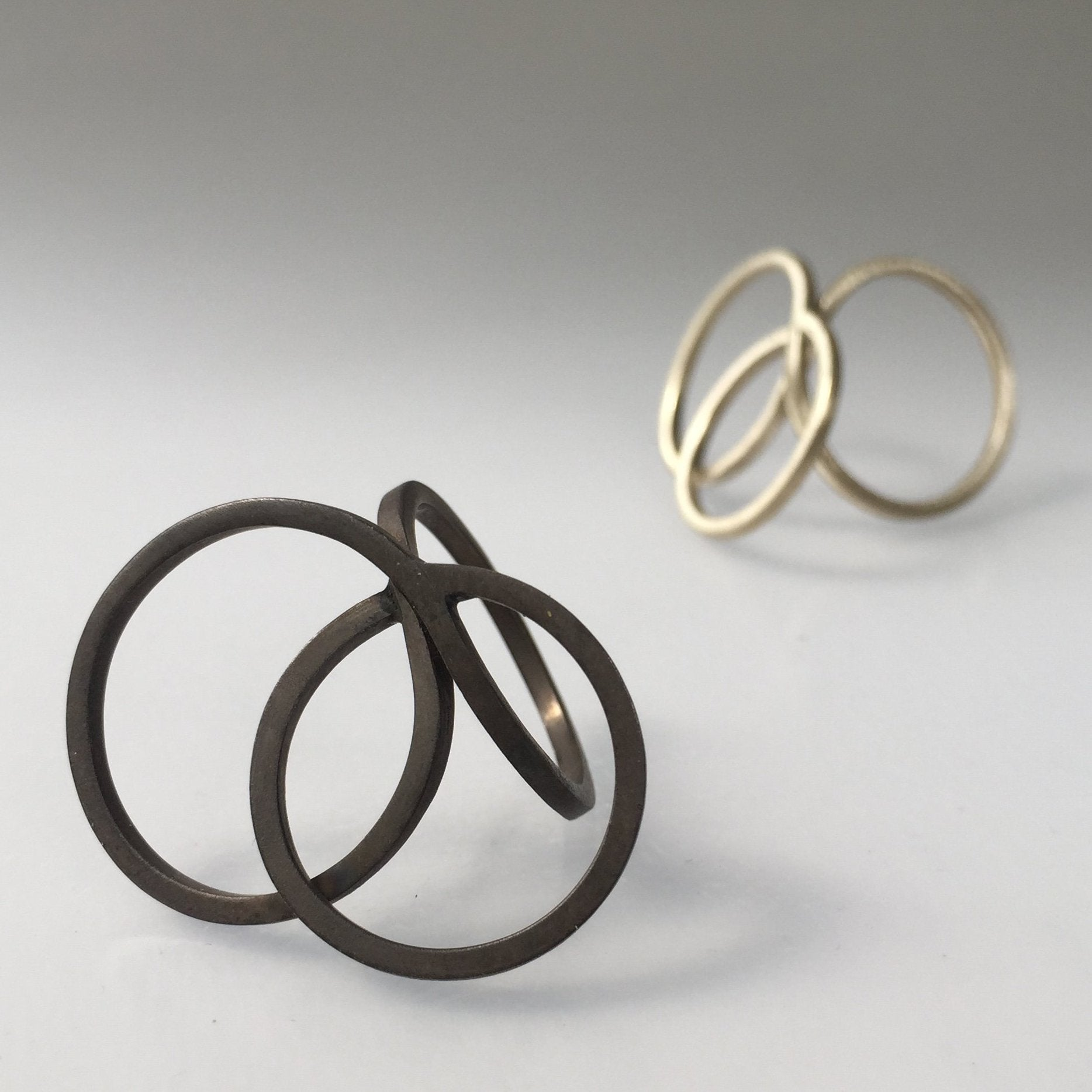 Two Loops Tangent Ring