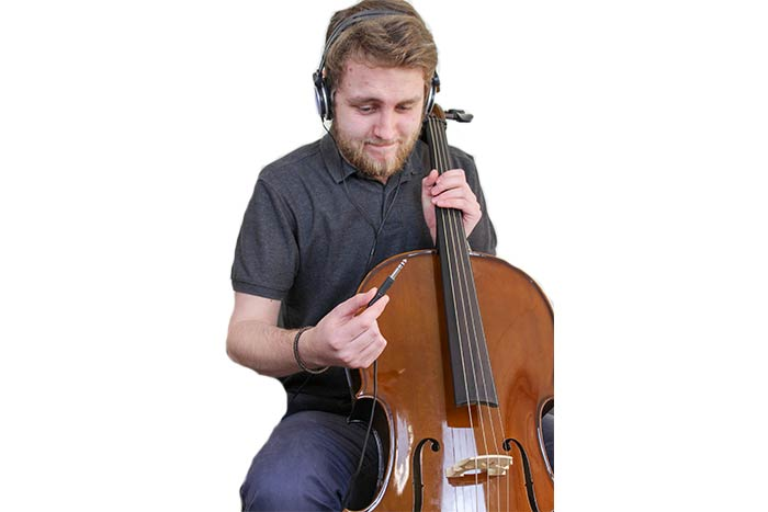 Jack with Cello and headphone looking confused
