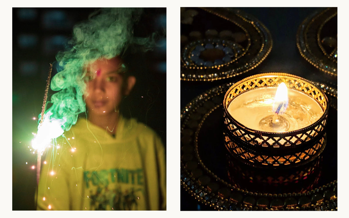 child with sparkle on Diwali and candle