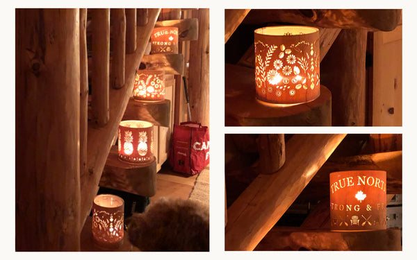 the true north lantern along with other designs on the stairs of a log cabin on weslemkoon lake