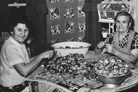 My great-grandmother and great-great-grandmother processing mushrooms in the kitchen