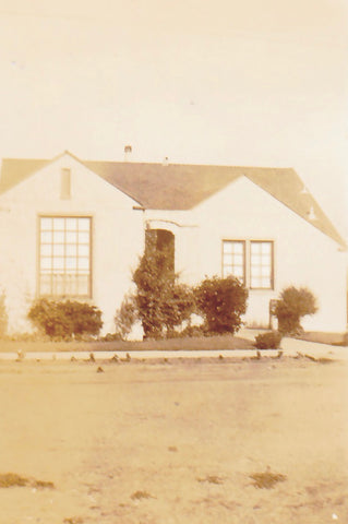 An old photo of my great grandparent's home where my grandmother was raised