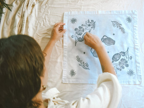 Haley of Hina Luna putting some finishing touches on a block printed altar cloth