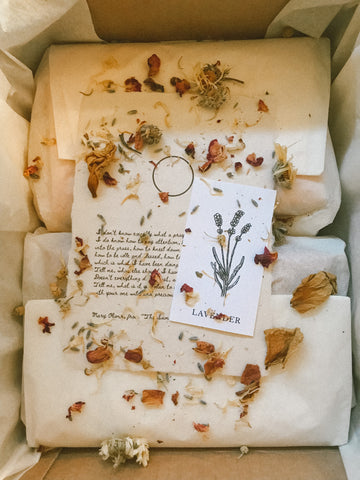 Hina Luna shipping packaging includes dried flower petals, a handwritten personalized note, a poem for the season, and a plant ally talisman card to inspire.