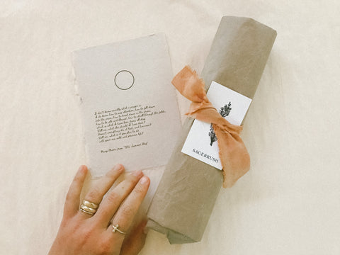 Hina Luna packaging wrapped in brown kraft paper and tied with a plant dyed ribbon