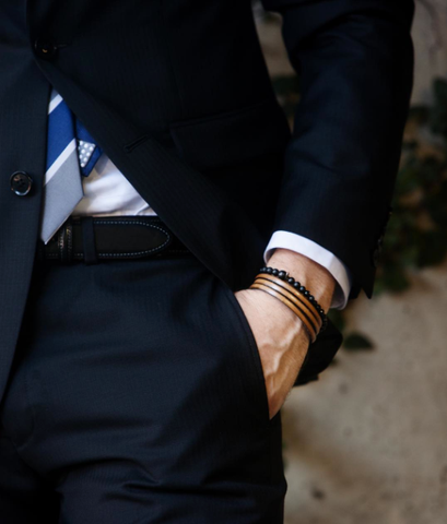 Tan bracelet with navy suit