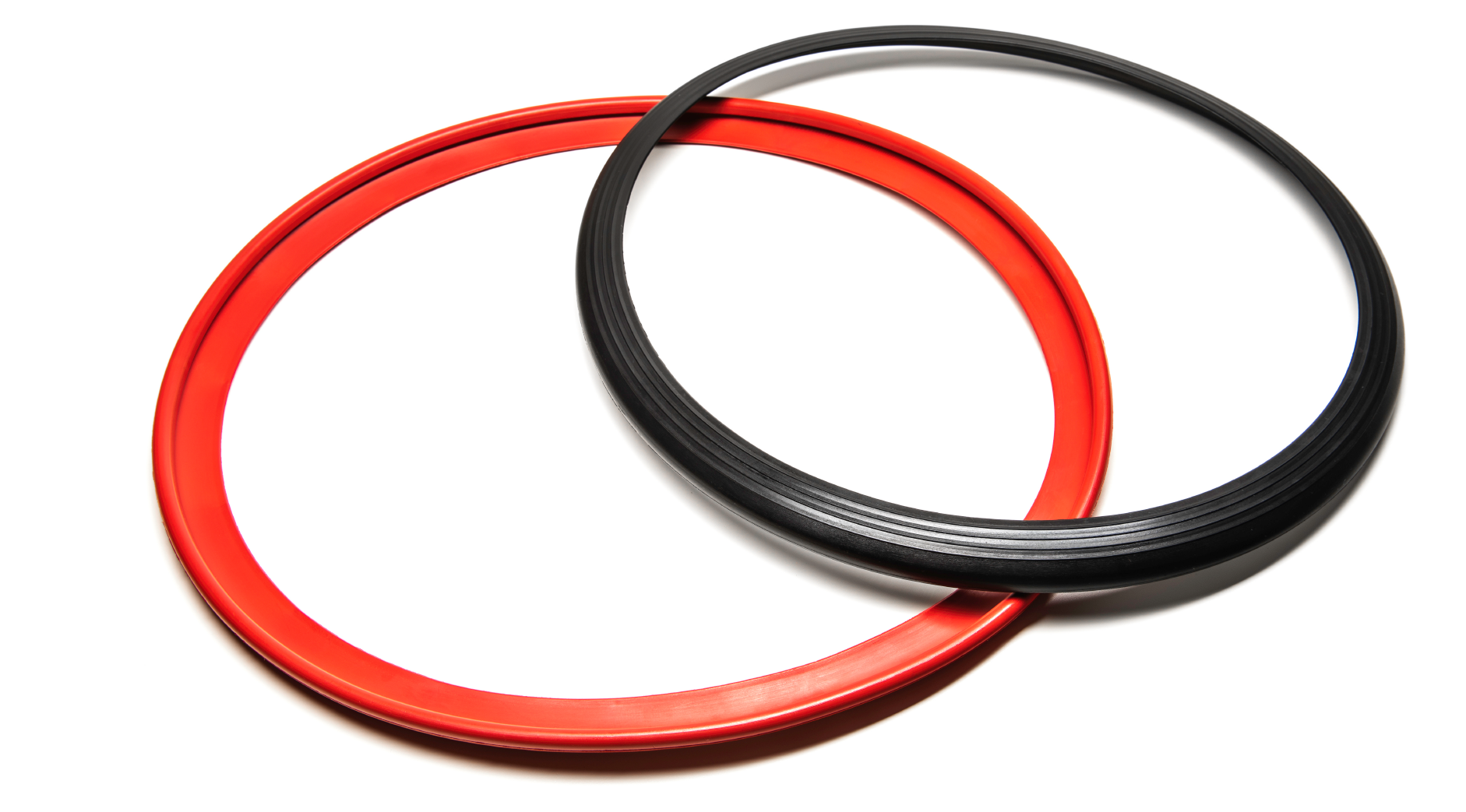 Overlapping black and red continuous rubber RIMFINITY product before fitting, on a white background