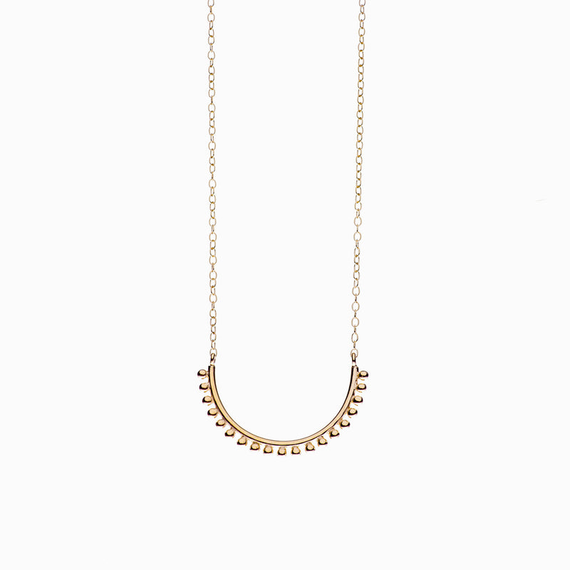 Pom Pom Necklace in Golden Brass by Naomi Murrell