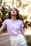Rosewater T-Shirt, Lavender Organic Cotton, Worn View 1, by Naomi Murrell
