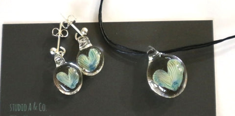 blue silvery heart shaped glass studs and pendant are display