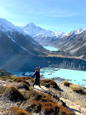 a person dancing background of Mountain Mt. Cook