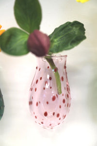 displaying pink wall vase on a wall