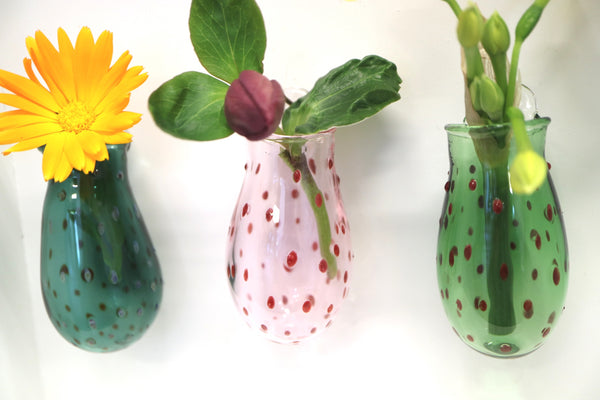 three wall vases in a line