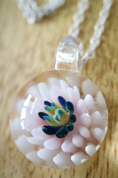 a close up shot of glass flower pendant