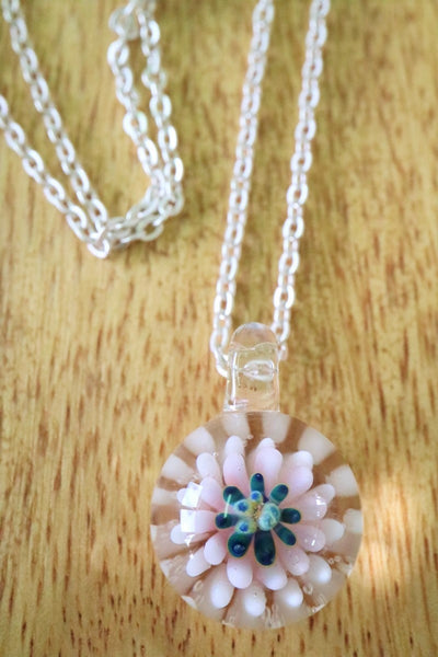 a glass flower pendant top with lots of layer of pink and white colours