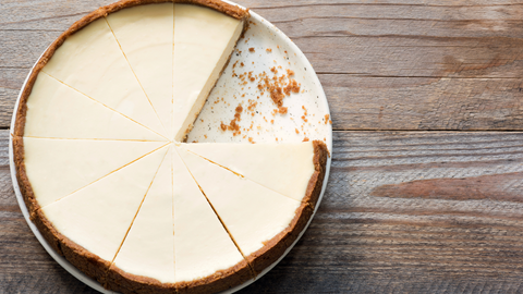 Image of cheesecake on a wood table top