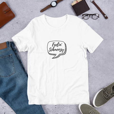 Feeling Schmoozy T-shirt on floor with jeans and accessories