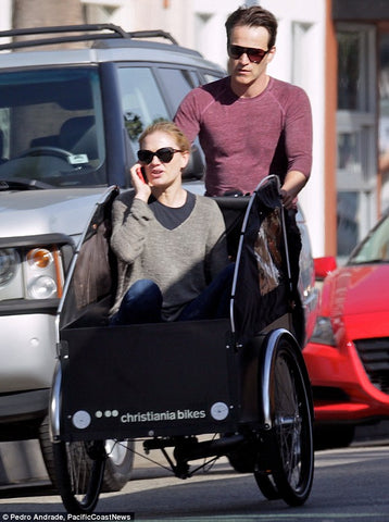 Pedal power: Stephen Moyer took wife Anna Paquin for a spin in the front of the family's cargo bike in their beachside community of Venice on Thursday
