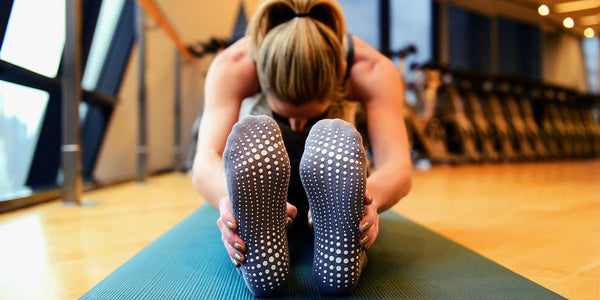 Is it better to practice barefoot or to wear yoga socks?